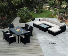Genuine Ohana Outdoor Sectional Sofa and Dining Wicker Patio Furniture Set (14 pc set) with Free Patio Cover by Ohana Collection. $2799.00. Sofa 7pcs set includes 2 Corner Sofas + 2 Middle Sofas + 1 Coffee Table + 2 Ottomans with BEIGE CUSHION. Factory Direct Price (MSRP $4999) Matching Black Wicker set.  Total 14 pc set.. Curbside delivery with signature required. All Weather Wicker 7pcs sectional sofa set plus 7 pcs dining set. Dining set includes 6 chairs.  Tabl...