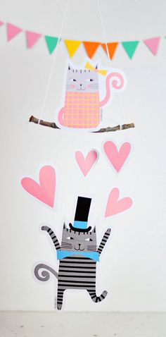 Valentine Cat Mobile with Free Printable. Cute Valentine decor! You can also make Valentine cards and favors with them.