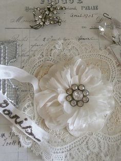 let's see...a few petals from an old silk flower...perhaps some cut out mesh inbetween....add some bling...done!