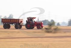 Couple of people in running Tractor stock photo