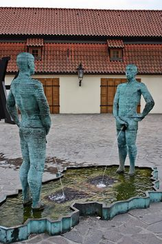 The Pissing Men statue/fountain by David Cerny. Prague, Czech Republic! I have a photo of a little boy staring at it. It was cuter unlike the guy who kept touching it later on.