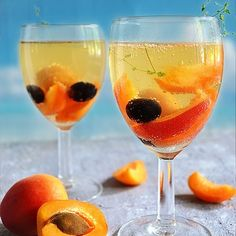 Apricot White Wine SPRITZER is an ideal beverage to serve at your next summer party! Combination of white wine, fruit and mineral water is all you need for this light cocktail drink.  Recipe #ontheblog on www.kitchenostalgia.com  RECIPE LINK: http://www.kitchennostalgia.com/drinks/apricot-white-wine-spritzer.html  #kitchennostalgia #apricot #wine #spritzer #summer #summertime #sun #hot #sunny #warm #season #seasons #instasummer #vacationtime #summertimeshine