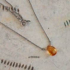 """A TINY AAA amber hued Citrine briolette between two 14k gold filled beads is wrapped to a delicate silver chain, finished with tiny silver nuggets and a spring clasp. The perfect everyday necklace...very elegant in it's simplicity. Metal - .925-.990 sterling and fine silver and high quality 14k gold filled. TINY Citrine - approx. 7x10mm (3\/8"""") This delicate necklace is 16"""" long and can be customized to any shorter length for no additional charge."""