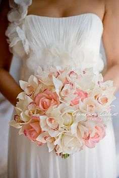White cymbidium orchids and pink rose bouquet