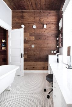 The clawfoot tub and small octagonal tiles are a classic, but the reclaimed barn wood ceiling and feature walls coupled with the crisp modern white vanity really takes this to another level.