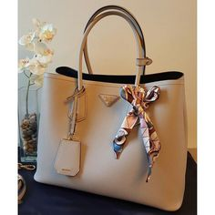 Preloved Prada Saffiano Cuir Double Bag. Bought in Jan 2015. Comes with TWILLY (not branded), shouder strap, authenticity card, and dust bag. Condition still as good as new. No scuff and stains. Very pretty grey color. Don't miss it!!!Dimensions/size: 35cm (L) x 25cm (W) x 17cm (H)Colour: Pomice (Light Grey)Condition: 9/10Selling Price: SGD $2,200Original receipt available: NoSeller's Contact: Please SMS/ Whatsapp at +65 94889907 #prada #bags