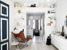 Loving the open shelving around a door in this swedish space.