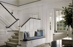entryway with basement steps | entry bench and farmhouse door | Basement & Stairs
