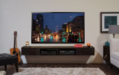Furniture. black wooden Wall Mounted Tv Cabinet with racks complete with large lcd tv on white wall. Astonishing Wall Mounted Tv Cabinet With Contemporary Idea
