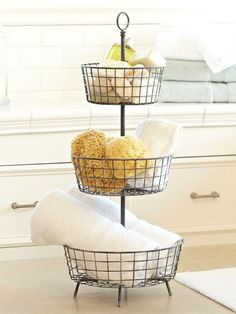 Organize soaps, sponges and more in a three-tiered basket that you won't be embarrassed to display on the counter or floor -- #creative #organization #bathroom
