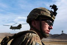 US Military told soldiers to ignore Afghanistan cohort's sexual abuse of children.  A U.S. soldier from the 3rd Cavalry Regiment waits for a CH-47 Chinook helicopter after an advising mission at the Afghan National Army headquarters for the 203rd Corps in the Paktia province of Afghanistan on Dec. 21, 2014.