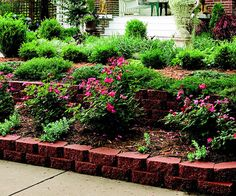Update Materials  Cheap-looking materials detract from a yard's appearance. For sloped areas that still need terracing, use cut stone or precast decorative wall blocks for an high-end look.   - Terrace back yard slope and use for garden