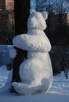 I wish I could create such an amazing tree hugger out of snow :-)