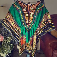 OFFER $20!!  Dashiki Tunic Bought in Nigeria (however, made in Thailand). Butterfly styled sleeve. Cinched at the waist. It's one size, but will fit as a cute oversized style for people sized small-medium. Will be nice and fitted for people who wear a size large. Not a halloween costume (culture is not a costume). Tops