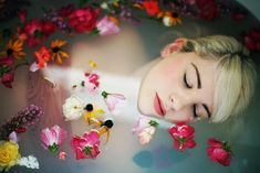 'Floral bath' by little body big heart on Flickr- love the idea of things floating in the water to create mood