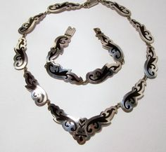 Vintage, post 1970s, Taxco Mexico sterling silver and enamel jewelry set •Necklace is 18 inches, bracelet is 7.5 inches •Each link had a black