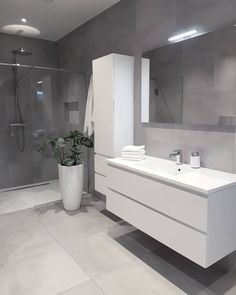 Wall Hung, Handle Less Bathroom Furniture And A Grey Colour Scheme Make  This Contemporary Bathroom Design Bang On Trend.