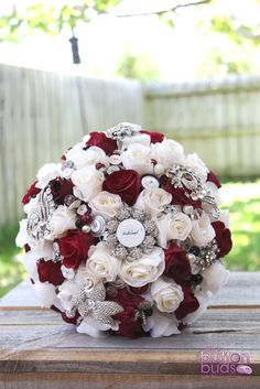 Artificial roses, buttons & crystals combine in shades of burgundy, ivory and pops of black.  Perfect for every bride or bridesmaid.