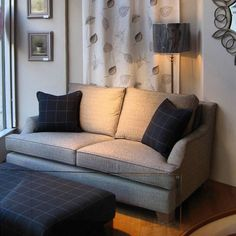 Wigmore Street's cool calm window display featuring our Hensington sofa with charcoal check accents. Wesley-Barrell