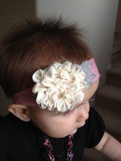 DIY Headband. Love the way she made the ruffle flower.