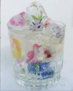 Borage flowers, calendula, rose petals, chicory flowers and more suspended in ice... Make sure they are organic and/or unsprayed : )