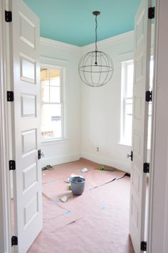 I really like the colored ceiling with fresh, white walls.  Adds color to the room with still plenty of decor options.