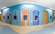 Beach huts in a paediatric ward at Salisbury Hospital. Artwork by Artcare at Salisbury Hospital. Wall Cladding, Public Art, Pediatrics, High Quality Images, Beach Huts, The Unit, Salisbury, Flooring, Hospitals