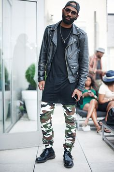 Leather jacket vs camouflage pants! Follow Sneak Outfitters for more cool street fashion snapshots from New York City. www.sneakoutfitters.com
