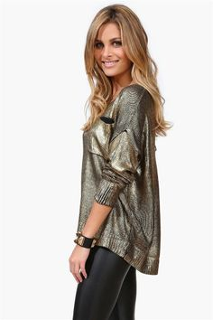 I love the gold/black sweater. Would go great with a pair of black leggings and boots.