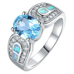 Peermont Blue Topaz & Opal Oval-Cut Ring ($20) ❤ liked on Polyvore featuring jewelry, rings, blue topaz rings, oval stone ring, blue topaz jewelry, opal jewellery and opal rings
