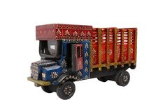 Ethnic Truck. An exquisite table décor that can be used for a variety of purposes. Will give a real country feel to your table décor.  (There may be very MINOR VARIATIONS in color combinations and figure designs, between displayed and dispatched products, due to variety of artisans who handcraft the products. The look, feel and quality will , however, be consistent with what you see. That is an Indikala promise).
