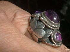 Old poison ring in silver with Amethyst from Mexico.