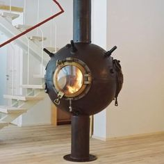 WW2 mine into a wood burning stove. Love the porthole for a door.