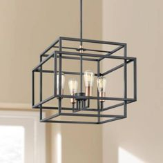 Prepare for compliments from friends and family upon seeing this striking open cube, black steel four-light pendant with modern-industrial charm. Includes two and two downrod stems. Style # at Lamps Plus. Chandelier Lighting Fixtures, Foyer Lighting, Industrial Pendant Lights, Rustic Lighting, Lighting Design, Pendant Lighting, Light Pendant, Black Chandelier, Pendant Chandelier