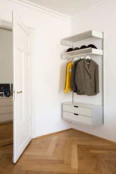 Make use of awkward areas. Shelf with hanging rail for hats and coats, and drawers for essentials