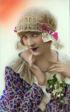 1920's beauty gazes demurely at the camera in this vintage tinted postcard | pinned via Corrine The'venet