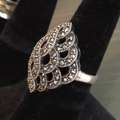 Sterling silver marcasite ring Beautiful Sterling silver, diamond shaped design marcasite ring. Lots of sparkle and dimension to this one! Minor scratches on band in the back that can be easily buffed out. Very good used condition! Sterling Silver Jewelry Rings
