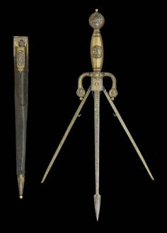 A GERMAN DAMASCENED LEFT-HAND DAGGER WITH EXPANDING BLADES, IN EARLY 17TH CENTURY STYLE -  19TH CENTURY