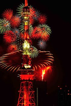 Fireworks at the Tokyo Tower in Japan.  Very pretty, is that radiation infused?
