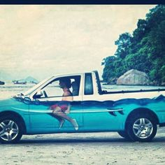 Fun photo and vehicle paint job!...look like you're always on your surfboard, waiting to catch a wave, no matter where you're really headed! ;)