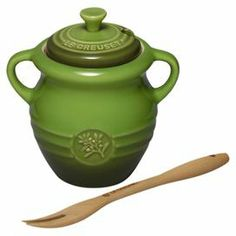 "Perfect for storing olives or essential ingredients, this lidded jar and fork set pairs enameled stoneware with a bright finish.    Product: Olive jar, fork and lidConstruction Material: Stoneware and woodColor: GreenFeatures: 12 Ounce capacityDimensions: 5.25"" H x 5"" Diameter (jar)"