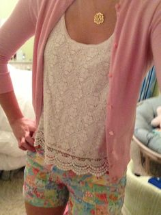 Floral shorts, lace shirt and pink cardigan.
