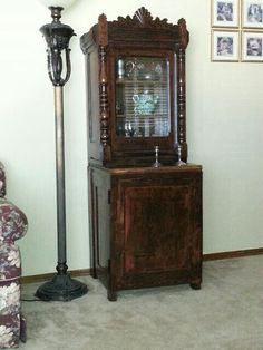 Top part of the cabinet belonged to my wife's grandmother.  It is estimated to be well over 100 years old. I stripped, hand-sanded, stained and sealed it to help preserve it.  My brother-in-law law built the base cabinet, then I refinished it.  ~