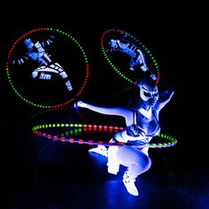 Cyr Wheel performance under black light. Crystal Light Show - Anta Agni.