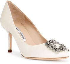 Ivory satin evening pump with a crystal embellished ornament from Manolo Blahnik. The Hangisi pump has a slightly pointed toe, a covered heel measuring approximately / Manolo Blahnik Sandals, Manolo Blahnik Hangisi, Satin Pumps, Fashion Heels, Women's Fashion, Wedding Shoes, Wedding Goals, Dream Wedding, Designer Shoes