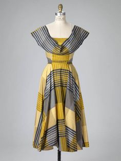 Woman's ensemble Unknown artist, American Woman's ensemble, ca. 1950 Cotton novelty-weave dress, bodice, and sash 83.109.3