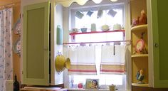 Love the cups hanging and cafe curtains.