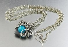 """Gorgeous silver plated pendant, with heart shaped Hematite, blue Jade, in a original silver braid. Beautiful, remarkable pendant, for a woman who likes unique jewelry :) Length of the chain - 50 cm (19.69""""); Pendant diameter is - 3 cm x 3 cm (1.18"""" x 1.18""""); Material: 925 sterling silver plated copper wire ; Stone: Jade; On request I make a similar pendant in other material - silver, copper, brass, silver-plated copper, bronze. Interested persons are welcomed to contact :)"""