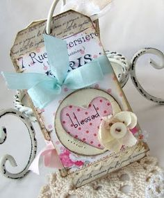 Another necklace, but could be a small magnet...  Beautiful shabby chic name tag idea/inspiration.