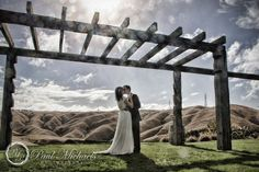 Bride and groom kiss at Ohariu farm wedding. New Zealand #wedding #photography. PaulMichaels of Wellington http://www.paulmichaels.co.nz/